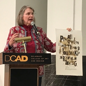 photo of Jill Cypher with poster at DCAD